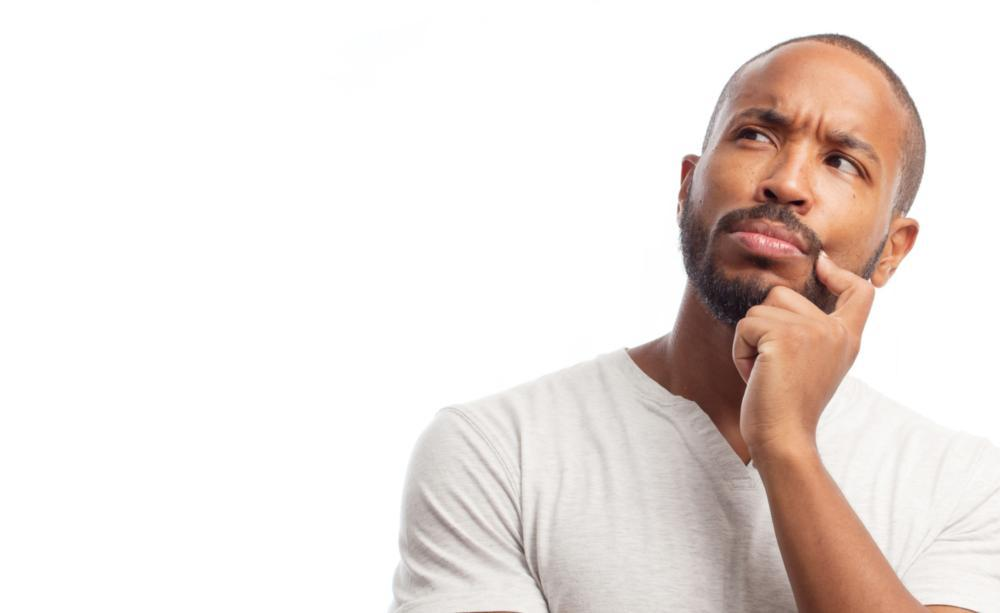 Man Thinking | Dental Crown FAQ | Saticoy Plaza Dentistry